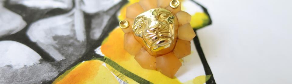 Bespoke gold lion head earrings by Tessa Packard London Contemporary Fine Jewellery
